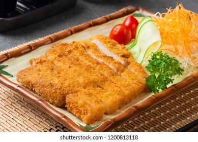 Japanese deep fried pork or tonkatsu set with rice in studio lighting.