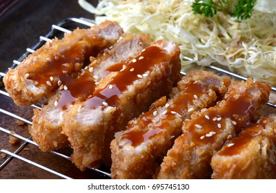 Japanese deep fried pork or tonkatsu set with rice in studio lighting.
