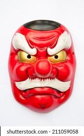 Japanese demon mask on white background