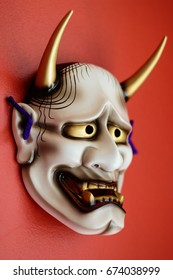 japanese devil mask on red background