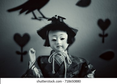 Japanese dolls have terrible faces, black and white images.