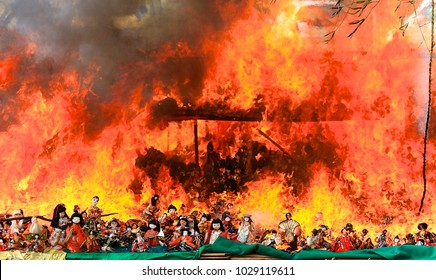 A lot of Japanese dolls in kimono burning on tiered stand during the Ku yo Otakiage Ceremony (A bonfire ceremony of farewell memorial service) at the Japan Shinto shrine partially magnified image 12