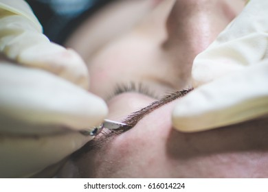 Japanese drawing eyebrows. Microblading eyebrows workflow in a beauty salon.