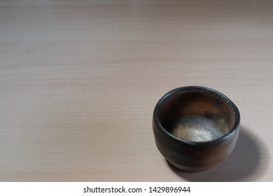 Japanese earth ware sake cup isolated