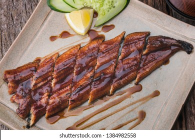 Japanese eel grilled with sweet sauce or unagi kabayaki cut and serve on plate.