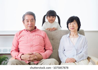 Japanese elderly couple and grandson relax