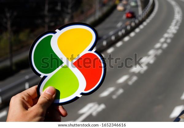 Japanese elderly people driving mark on traffic road