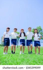 Japanese elementary school students dressed in training wear