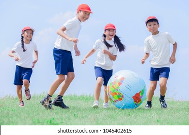 Japanese elementary school students playing in the globe