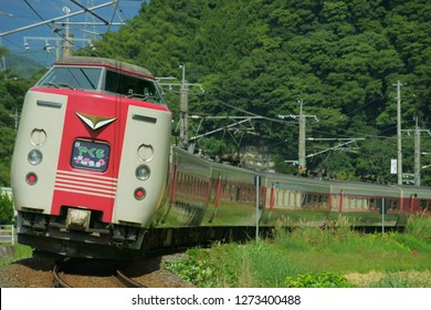 """Japanese express train running in the mountains. """"やくも"""" means Yakumo (name of the train)."""