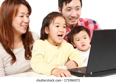 Japanese family on laptop computer