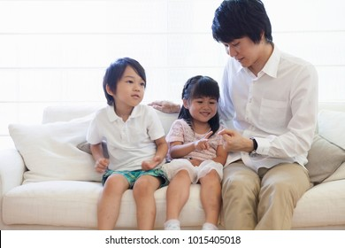 Japanese family sitting on the sofa