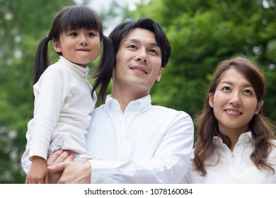 Japanese family standing in park