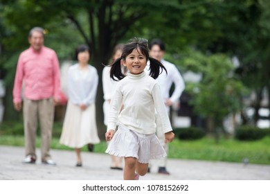 Japanese family walk in the park