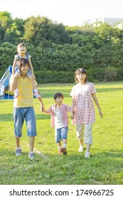 Japanese Family walking on the campsite and holding hands