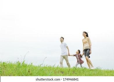 Japanese Family walking on the river bed