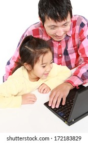 Japanese father and daughter on laptop computer