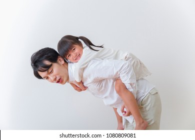 Japanese father playing with daughter