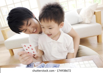 Japanese Father and son playing cards
