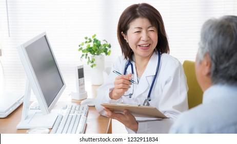 Japanese female doctor examining