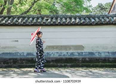 Japanese female kimono and umbrella