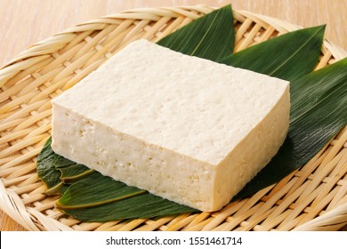 Japanese firm tofu on bamboo strainer