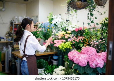 Japanese flower shop woman