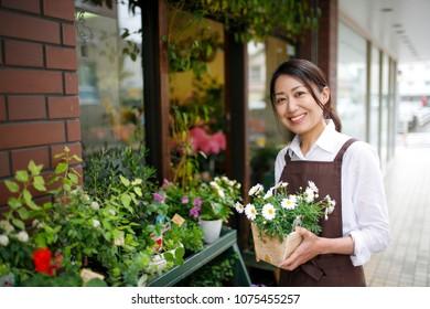Japanese flower shop woman