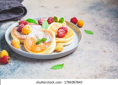 Japanese fluffy pancakes with raspberries in a gray plate, gray background. Japanese cuisine concept. - Shutterstock ID 1784387843