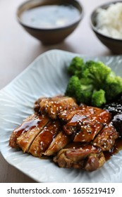 japanese food , Chicken teriyoki with rice on wood background