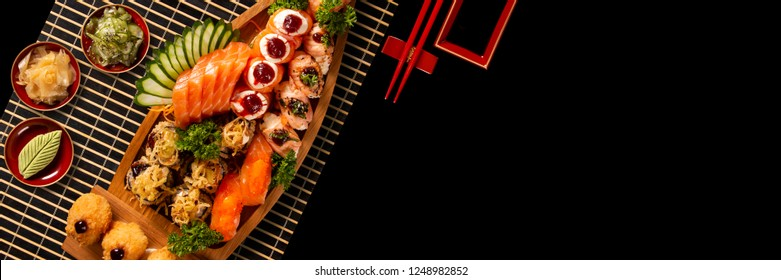 Japanese food combo in black background. Advertising format, top view.