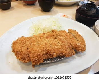 It's Japanese food. It's a fried pork set at the restaurant. By the sliced cabbage in the plate near the fried pork.
