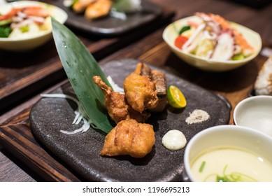 Japanese food : karaage, grilled salmon, seafood salad, steamed egg