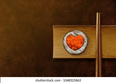 Japanese Food Lover Concept. Roll Sushi with Heart Shape, Serve on Wooden Plate and Chopstick. Topview with Copy Space