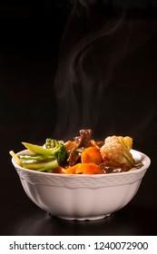 Japanese food. meet and vegetables with smoke. Yakisoba.