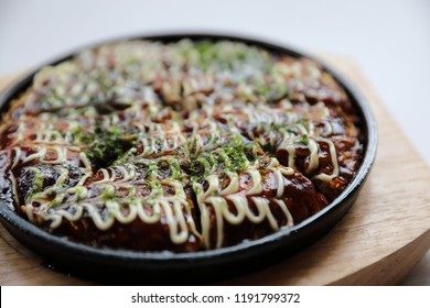 Japanese food okonomiyaki , Japanese pizza on wood plate