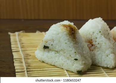 Japanese food Onigiri  white rice formed into triangular or cylindrical shapes and often wrapped in nori.