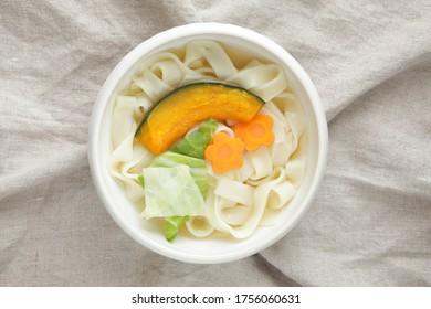 Japanese food, pumpkin and carrot in flat udon Kishimen noodles