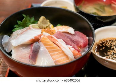 Japanese food with raw fishes, called sashimi on the rice in Bowl in Hakodate morning market, Hokkaido, Japan.