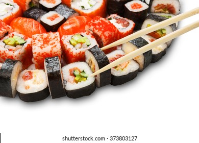 Japanese food restaurant delivery - sushi maki california roll platter set isolated at white background closeup with wooden chopsticks taking one piece