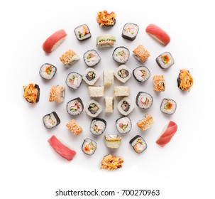 Japanese food restaurant delivery - tuna sushi maki, salmon rolls and spicy gunkans big party platter set isolated on white background, above view