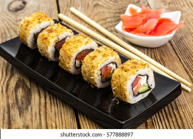 Japanese food rolls with fish and avocado. Studio Photo
