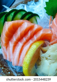 Japanese food sashimi salmon and set different types of sushi with seaweed salad and gari (ginger) is a healthy food at the upper right of the serving board in japanese restaurant