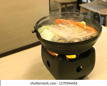 Japanese food, seafood and vegetables in mini shabu sukiyaki soup hot pot for one person eating