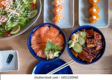 Japanese food set of Salmon don, Salmon sushi roll, Unagi donburi and Salmon salad.