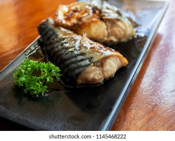 Japanese food style , grilled Saba fish in dish on wood table.