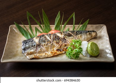 Japanese food style , Saba fish grilled. in dish on wood table