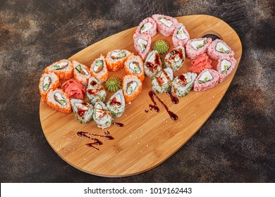 Japanese food sushi maki rolls set on wooden board, heart shape for valentine day