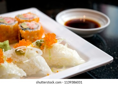 Japanese food, Sushi and Sushi roll made from fluke fin and seasoned rice with seasoning sauce(Shoyu) in a dipping bowl.