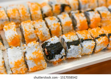 Japanese food sushi roll rice with Tobiko egg is orange (flying fish roe) nori in the restaurant sushi menu set Japanese cuisine fresh ingredients on tray , selective focus